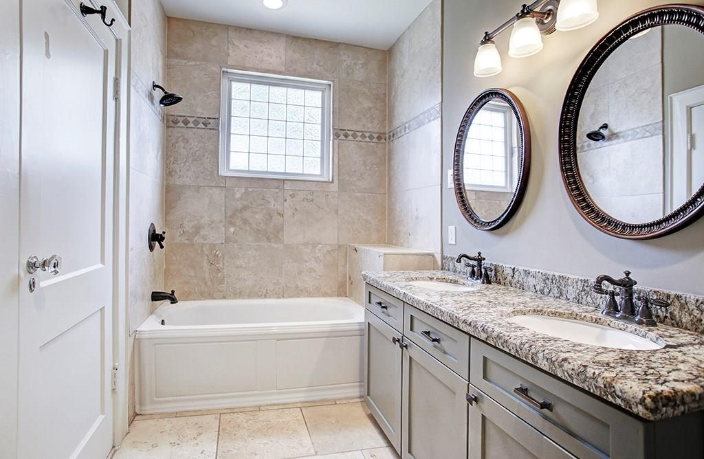 Another view of the master bath showing the tub/shower and lovely finishes.