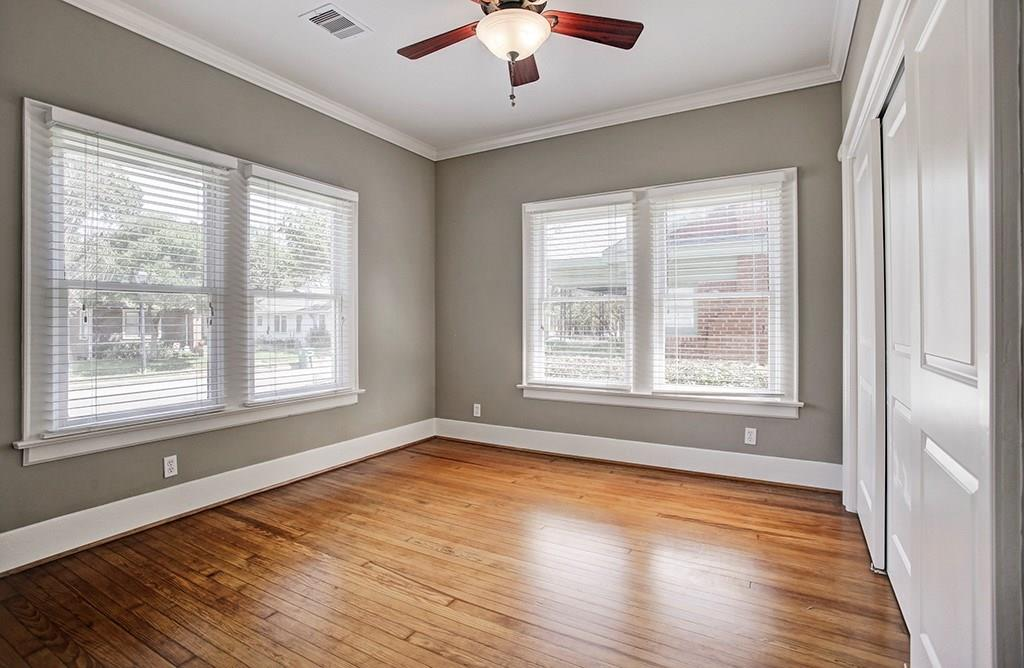 The second bedroom is located off the living room at the front of the home. There is wonderful closet space in this bedroom as well (sliding doors to the right).