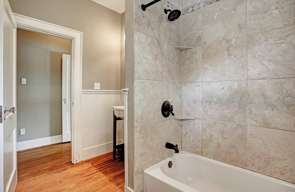 The guest bath is updated as well, and has a shower/tub combo.