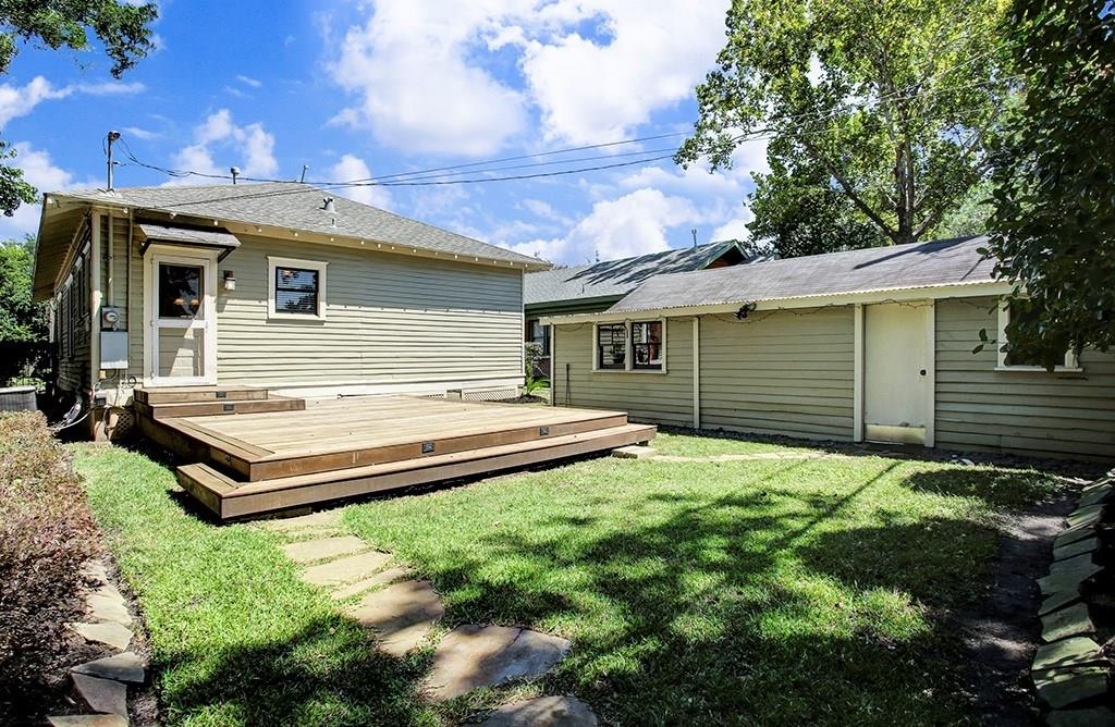 The back yard is fenced and includes a spacious deck.