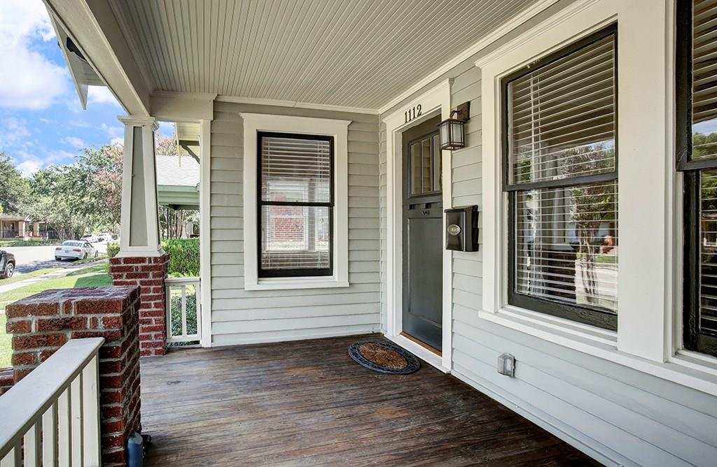 The covered front porch provides a lovely place to sit and enjoy the neighborhood!