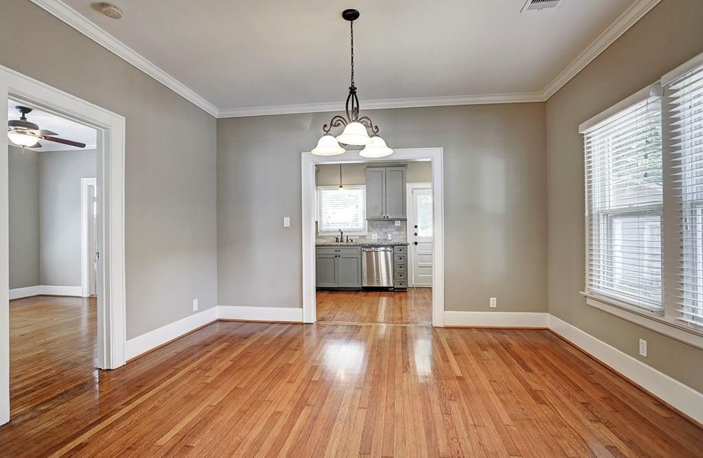 The formal dining room can readily accommodate a table and chairs as well as other dining storage pieces.