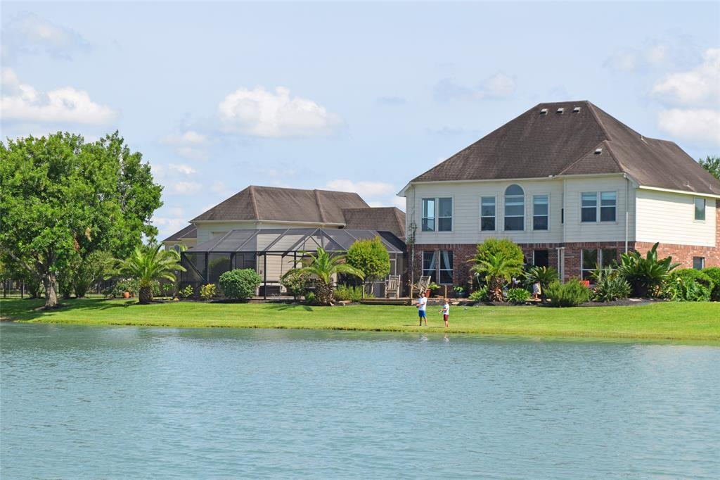 This Beautiful home is located on a unique, water lovers, ski lake community. This small quiet tight nit neighborhood has a security gate entry, a boat launch, and multiple parks and fishing piers. They have annual national ski contest here w/ vertical trick ramps & grinding rails. You will not find another place like this in Hou. The house has 2 masters, an big island kitchen, a large gameroom, travertine floors, screened in pool & outdoor bar/ kitchen, boat house w/ top deck, RV garage w/ hook-ups, fenced in dog run, water softener, and much more.