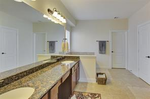 Look at the size of this Master Bathroom with His and Her Vanities!