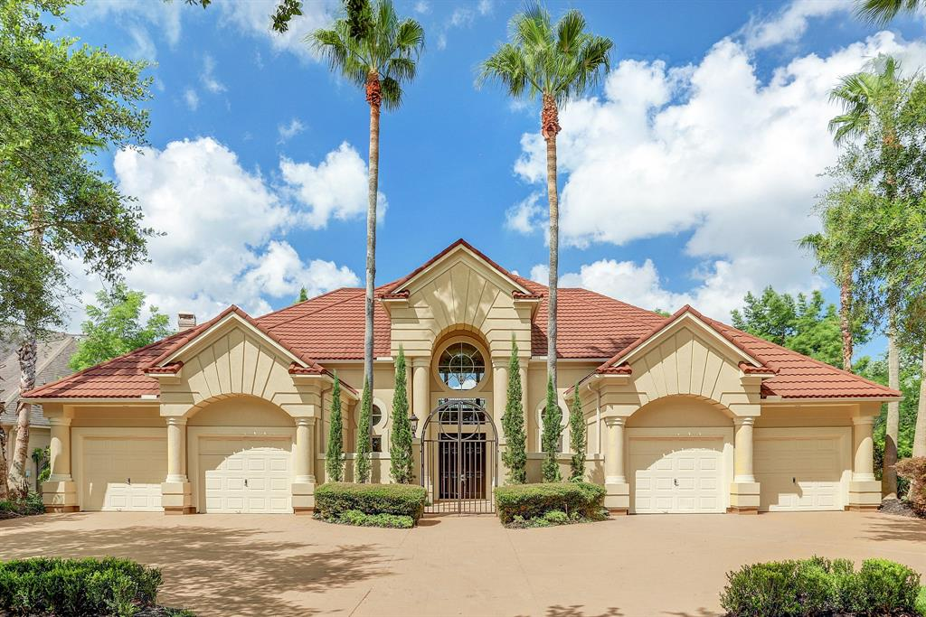 Stunning Mediterranean custom home in exclusive gated neighborhood of Point Royale situated on 2-sided lake lot with amazing views. The front gated court yard leads to the double door entry.  Inside, the grand double staircase frames your first lake view beyond the formal dining room. Two curved window walls showcase the pool and lake views from both the kitchen/family room and from the master bedroom. The chef's kitchen features two islands with granite, stainless appliances, double ovens, wine bar and 2 pantries. The master suite exudes luxury with its shared fireplace with the bath & huge closet with built-ins - adjacent extra room could be a sixth bedroom, gym or nursery. Exquisite travertine flooring through much of the first floor with recently replaced carpeting in the bedrooms. Fresh paint throughout, and custom built-ins abound. Back yard paradise features resort style pool, covered patio and balcony. Upstairs bedrooms amaze with huge picture windows overlooking pool & lake.