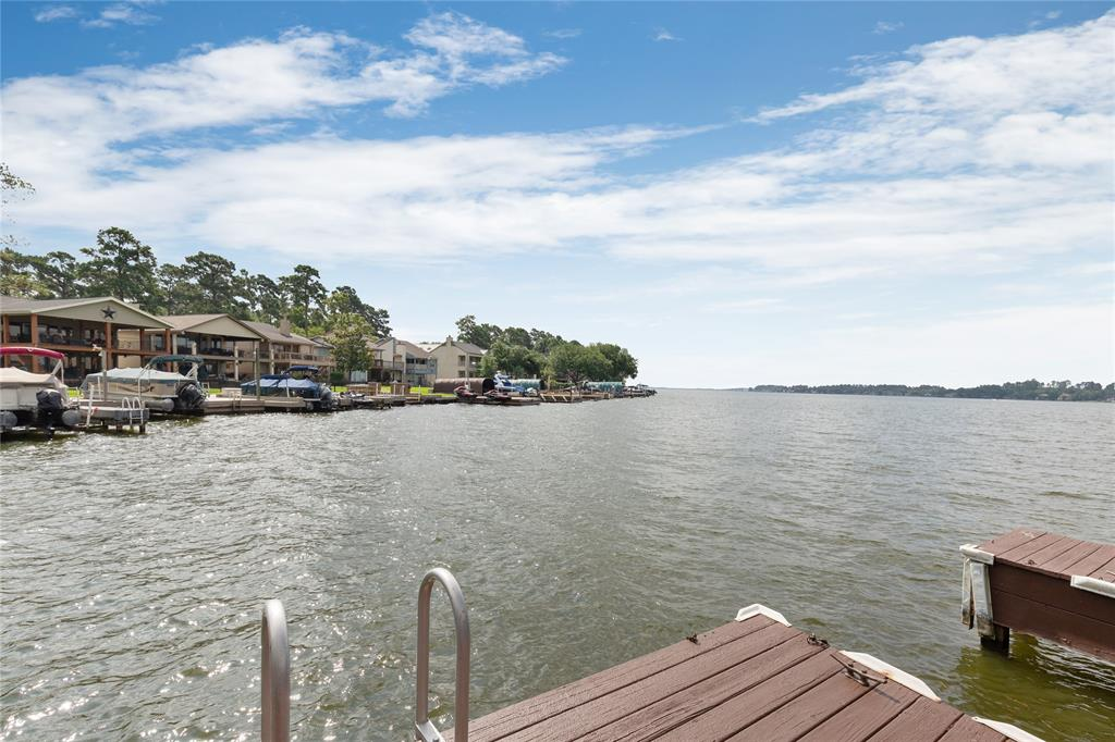 WATERFRONT home with stunning views of LAKE CONROE. Every room of this beautiful home has been updated with quality finishes. Soaring ceiling in living room with a wall of windows, and woodbruning fireplace. All new kitchen with high end appliances, leather granite counters, and all new quiet close cabinets. Enjoy your morning coffee overlooking the lake in the expanded breakfast room. Every bedroom has a private bath with granite counters. Double boat slip configured for a boat and two jetskis. Sit out on the upper deck and enjoy the evening breeze while watching the kids play in the no wake area. This is a great retreat for anyone looking to get away from the hustle and bustle of the daily life. Walden has many enjoyable amenities such as fitness room, racket club with multiple courts, yacht club, walking trails, and much more.
