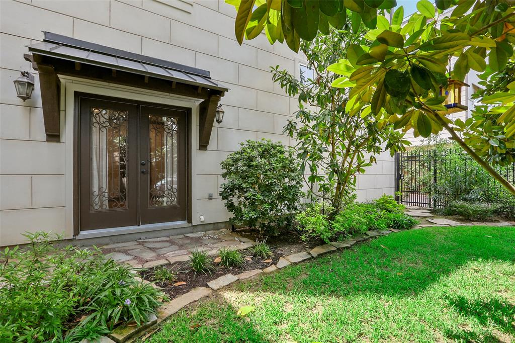 End-unit patio home in a gated community with a fenced yard.