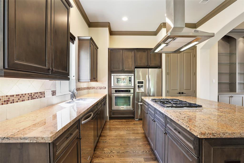 The center-island kitchen features granite counter tops, stainless-steel appliances and lots of storage.