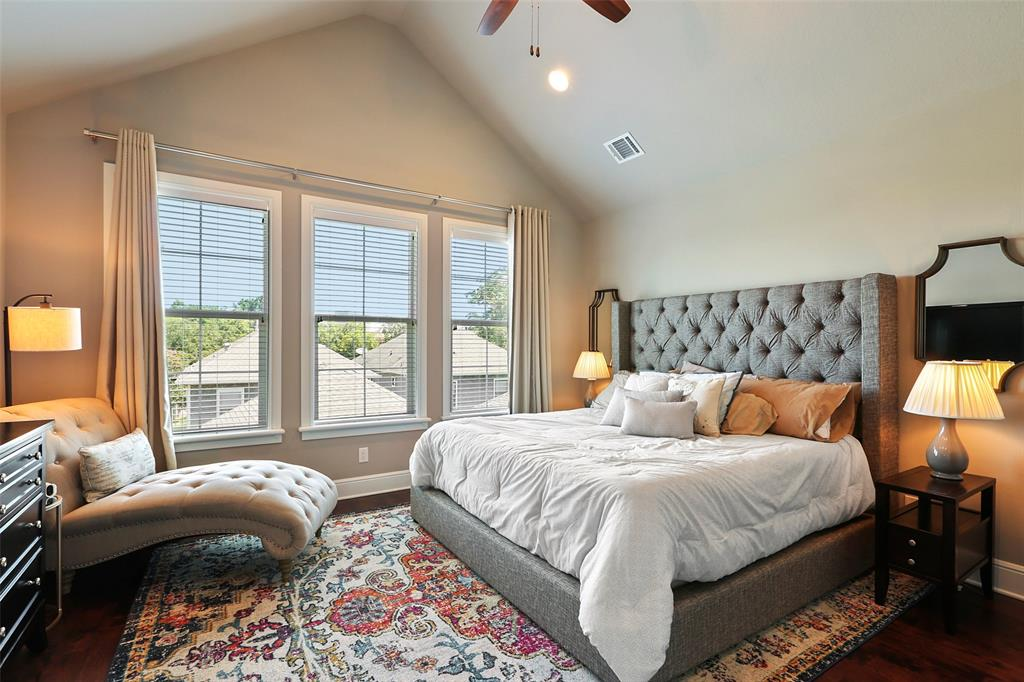 The spacious master suite features a vaulted ceiling, walk-in closet and lots of natural light