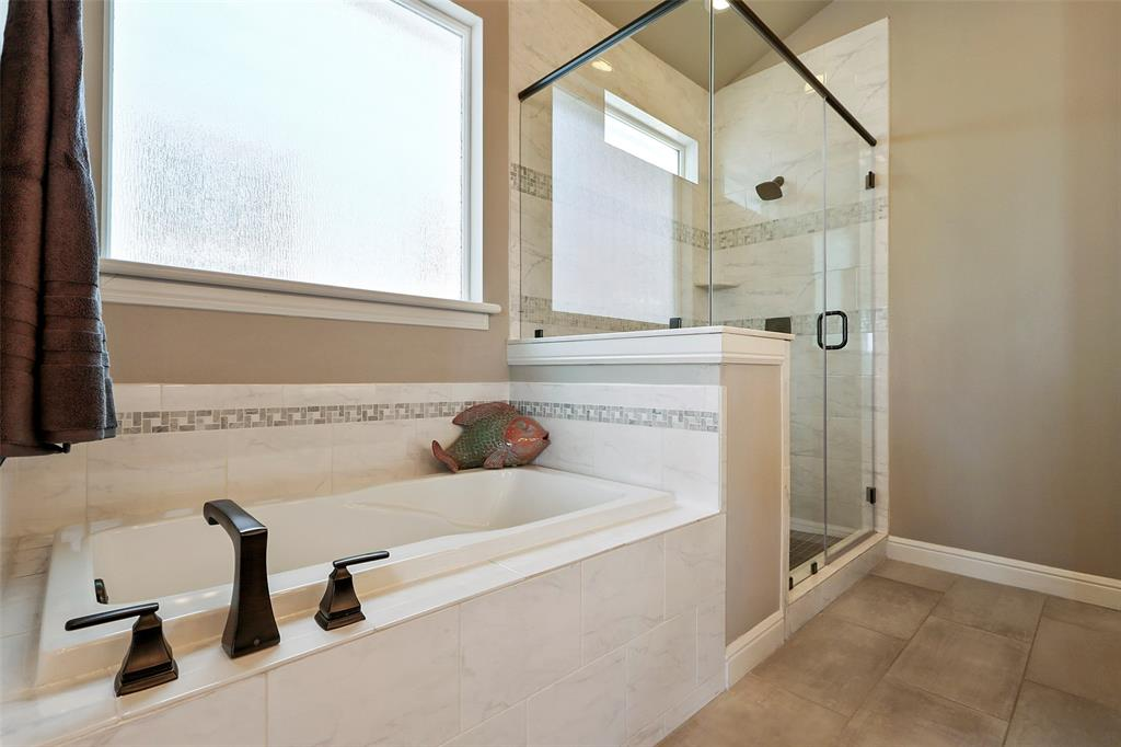 The master bath features a large shower with separate tub