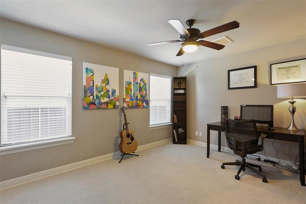 The spacious first floor bedroom can also function as a study or exercise room.