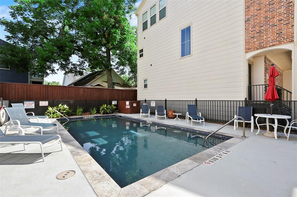 Cool off or enjoy a glass of wine at the community pool