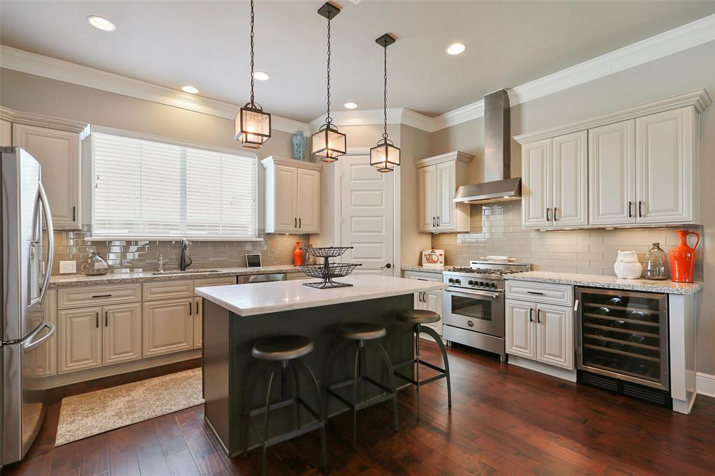 The center-island kitchen features a Bertazzoni range, lots of storage and counter space
