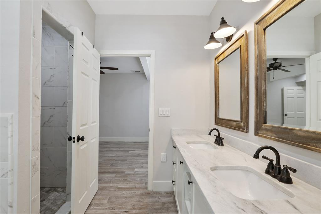 Master bathroom provides a great space to start your day. You and your significant will have plenty of room to move around with the double vanities, large quartz counter top, and glass-less separate shower.