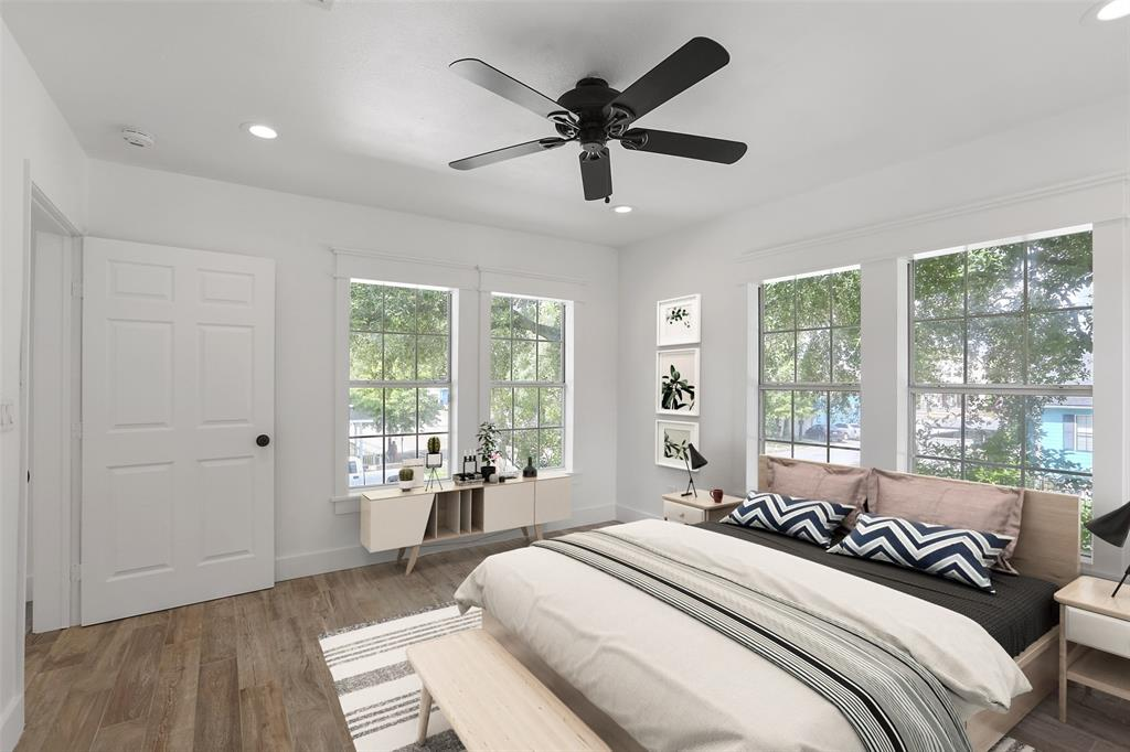 Here's another room with plenty of space for your guests.  Like the others, the secondary bedrooms all include recessed lighting, tile floors, and a ceiling fan. This image has been virtually staged.