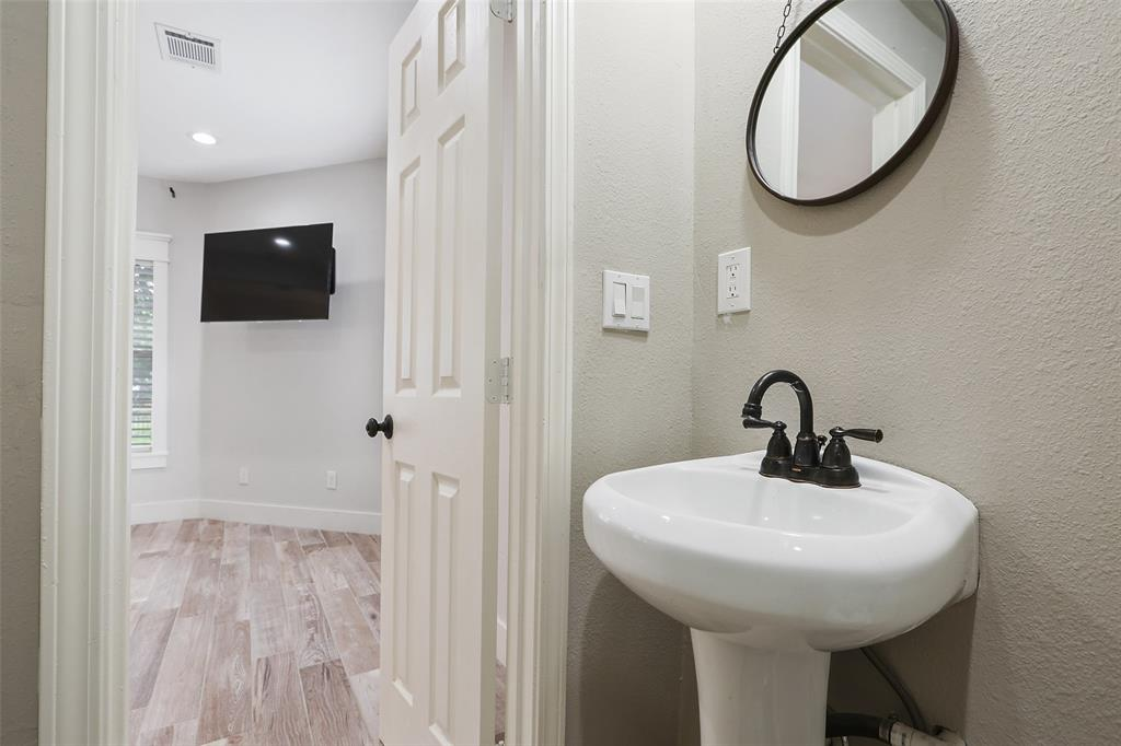 This half bath is conveniently located downstairs off of the main living space.
