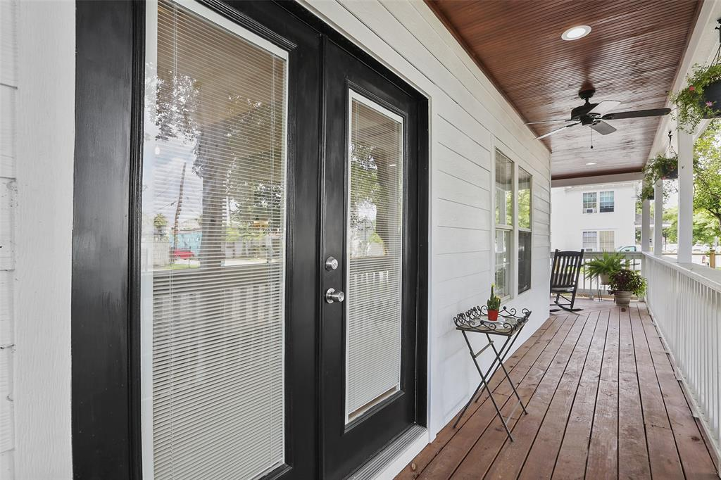 Here's another view of the gorgeous wrap around porch.  The wood spindle handrails complete the classic farmhouse charm.