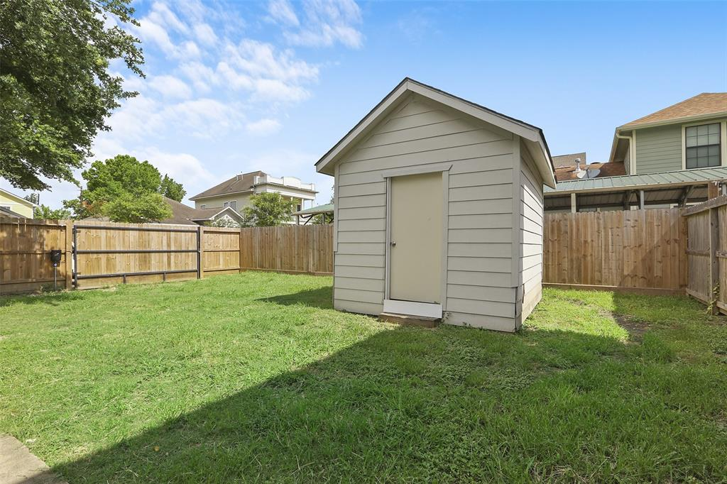 Outback, you'll find a huge backyard with a privacy fence that runs around the entire space. You'll also find plenty of space for your gardening tools in the backyard shed.