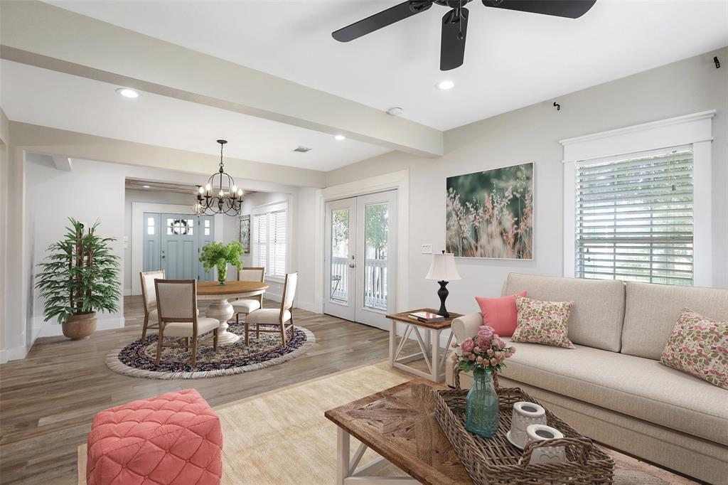 This open floor plan offers plenty of space for a dining room table.  Through much of the main living space and upstairs, you will find Wood look tile and recessed lighting.  Per the sellers, many of the spaces throughout the home include both LED lighting and soft light options. This photo has been virtually staged.