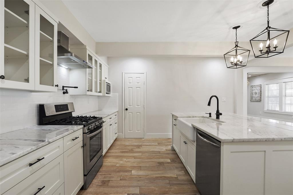 Appliances were also replaced in 2017.  The the gas range includes 6 burners with overhead, stainless steel vent hood. A pot filler is conveniently located right over the range.  You'll also love the large farmhouse sink with a single handle pull down faucet. The shaker style custom cabinetry is all soft close and includes beautiful oil rubbed bronze hardware. You're also going to love the extra storage in that nice sized pantry.