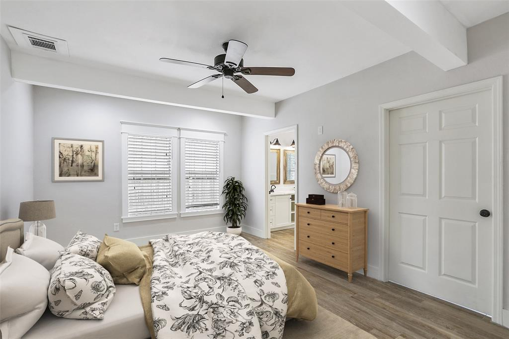 This large master suite is conveniently located on the 1st floor. This image has been virtually staged.