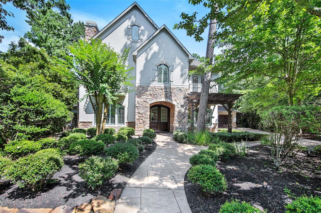 Stone and stucco Croix Custom Home in Carlton Woods!  Impressive interior wooded cul-de-sac lot with private pool/spa and true 3 car garage.  Beautiful extensive remodel and updates.  Gorgeous open floorplan with hardwoods, granite, ornate custom lighting, curved staircase, two story ceilings, and 2 fireplaces.  5 Bedrooms, Formals, Study, upstairs gameroom.  Elegant Master suite with modern freestanding tub.  Gated Woodlands community.
