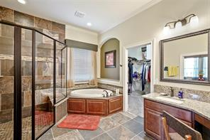 Separate large shower and tub looking into huge 8  x 13 walk in closet!