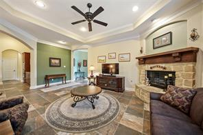 Gorgeous stone fireplace in family/living room. Open to kitchen on the left.