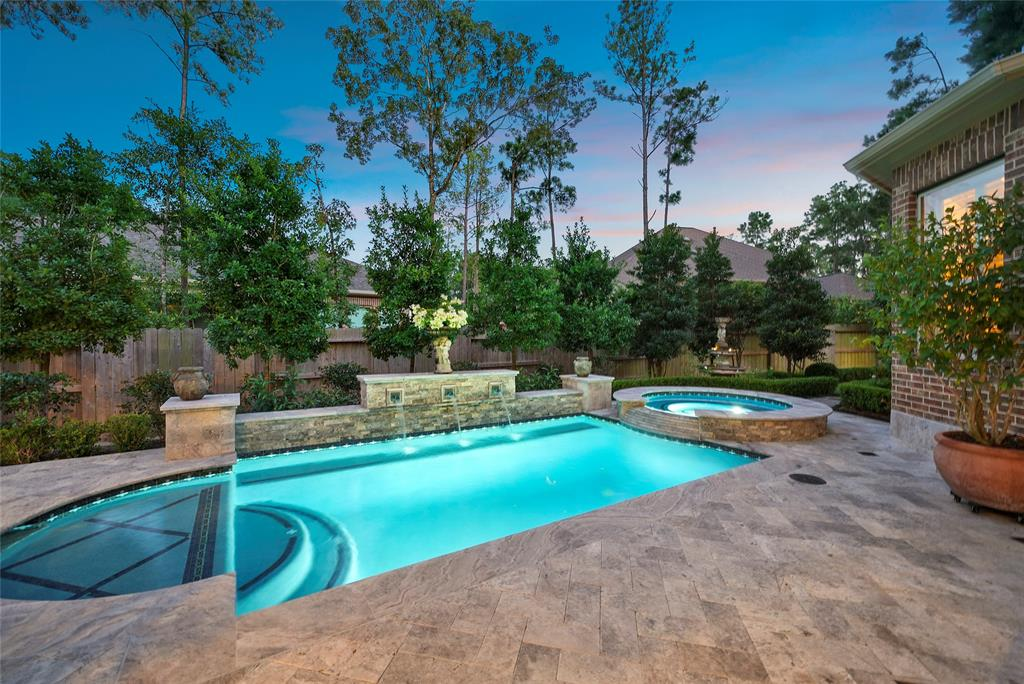 Executive Home Oversized Elevated Lot, Audubon Grove of Springwoods Village, Adjacent Exxon & HP Campuses (4 Min I-45, Hardy & 99 Grand Pkwy) 1 Exit South The Woodlands & All Amenities. Over $125K in Upgrades: Modern Pool & Spa, Superb Outdoor Living & Resort Landscaping w/ Covered & Raised Travertine Loggias/Kitchen/Living Transcend to True Oasis Every Day! 5 Bedroom Home Welcomes w/ Designer Awnings, Elegant Formal, Study, 2 Story Family Areas w/ Panoramic Outdoor Splendor Views, Chef/Entertainers Island Kitchen w/ On-Trend Countertops & Cabinetry. Plush Master Suite off Pool & Grounds. Games, Theater, Generous Guest/Children Suites. Plantation Shudders. 40X20+ Oversized Garage w/ Bonus Space current Home Gym: Future Guest Quarters! Enjoy Community Walk & Bike Paths to CityPlace Plaza's Events/Concerts & Dining, Marriott Conference Resort & Star Grill Cinema. Direct Access to Spring Creek Greenway-a 150 Acre Nature Preserve. High & Dry Thru Harvey!
