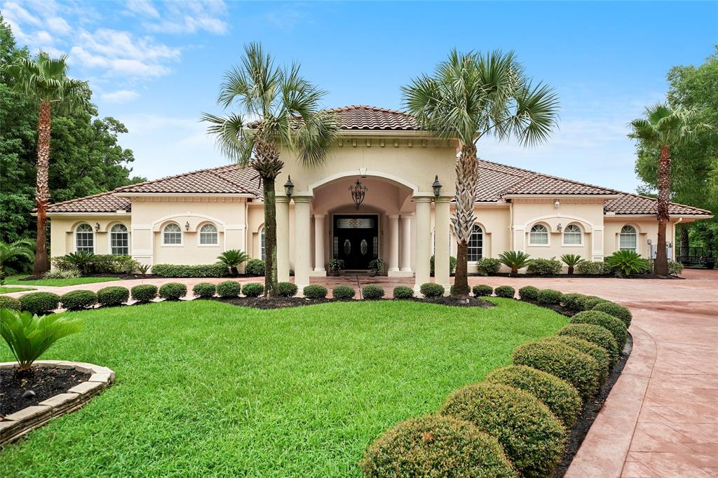 Exceptional Lakefront Living located within the secured Community of Riverwalk! This pristine waterfront 1 story home offers 5 bedrooms, 6 baths & 3 half baths that sits on 1+ Acres on the lake with the upmost curb appeal. This Mediterranean style home is sure to take your breath away at the grand entrance into the foyer over looking the formal dining room into the large living & kitchen areas, showcasing picturesque windows with astounding views of the lake & the heated Infinity pool in the backyard. Perfect for entertaining family & friends and it even has it's own boat slip! This gem features a massive master suite & bath with a raised garden tub, large walk-in closets, an in-home gym, a huge gameroom w/a wet bar & a boat house! This home has so many upgrades you must see it for yourself! Home has a conventional septic system & propane gas. Low HOA Fees! Low Taxes! Great Schools! Schedule a showing today!