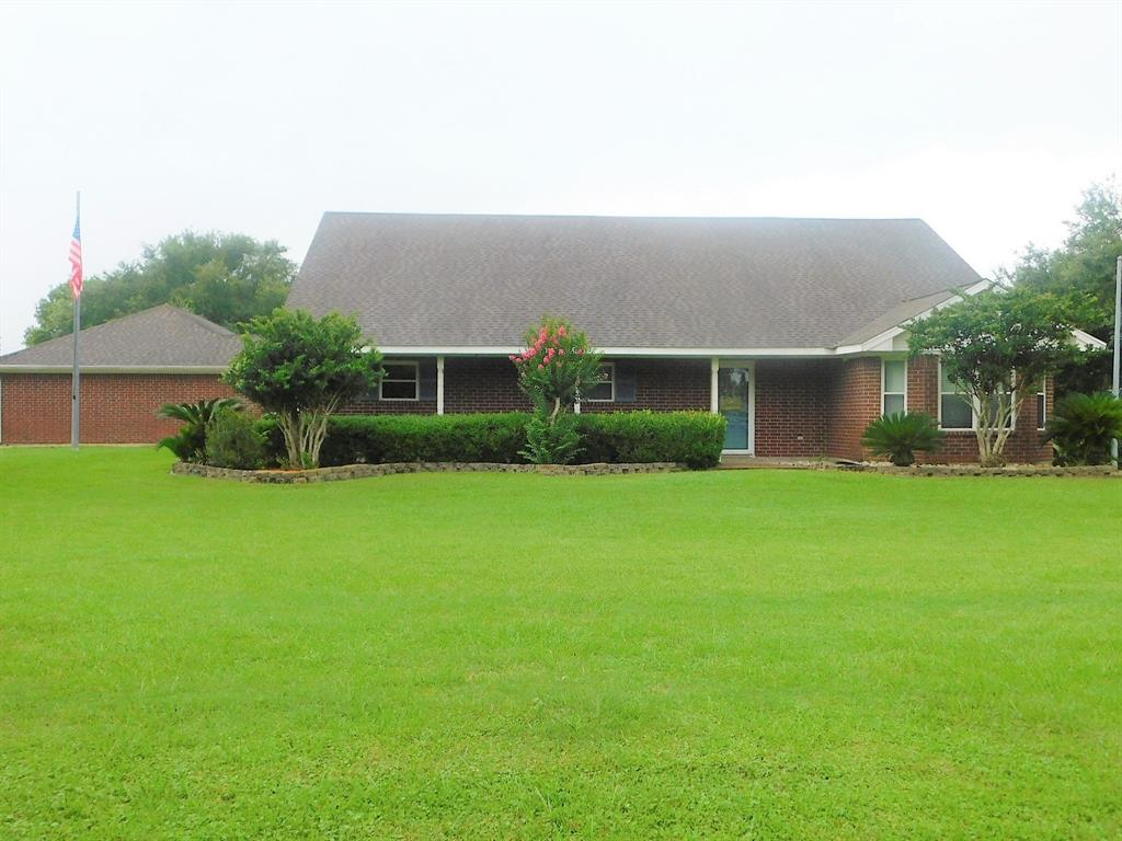 WHAT AN INCREDIBLE PLACE, THIS IS THE ONE YOU HAVE BEEN WAITING ON, RELAXED COUNTRY LIVING CLOSE TO TOWN AND US 59 AND SPUR 10, ALL THE AMMENTIES OF COUNTRY LIVING AND PRIVACY ALSO, HOME IS DESIGNED FOR FAMILIES, KITCHEN AND BREAKFAST ROOM ARE OPEN TO NICE SIZE DEN WITH FP AND EASY ACCESS TO BACKYARD AND POOL AND OUTBLDGS.  HOME SITS ON 5 ACRES, OWNER PLANTED OVER 30 TREES AND THE OAKS HAVE GROWN UP, POOL HOUSE BEHIND THE IN GROUND POOL, FLAGSTONE SURROUNDS THE POOL AND A LARGE COV PATIO, THE WHOLE 5 ACRES IS FENCED AND THE POOL AREA AND GYM AND GUEST QUARTERS ARE PRIVACY FENCED ALSO, ON REAR OF PROPERTY IS A POLE BARN AND A SMALL SHOOTING RANGE. HOME WAS CUSTOM BUILT 93, POOL ADDED IN 2000, POOL HOUSE (WITH WORKOUT RM AND APARTMENT ADDED IN 2000), NEW AC SYSTEM IN 2017, WINDOWS 2006,  LIST OF IMPROVEMENTS AVAILABLE. HOME IS AN OPEN CONCEPT WITH LARGE FMAILY ROOM OPEN TO LARGE BREAKFAST AREA AND BIG OPEN KTICHEN WTIH GRANITE ISLAND. SO MANY AMMENTIES.