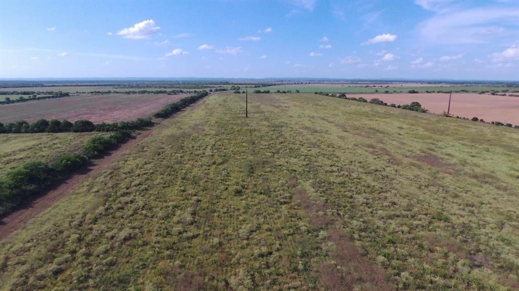 Highway 90  frontage with approximately 100 acres now available.  Property stretches from Highway 90 to County Rd 301.  Unlimited possiblities for usage of land....live stock, farm land, ranch, residential and even commercial.  Call for an appointment today