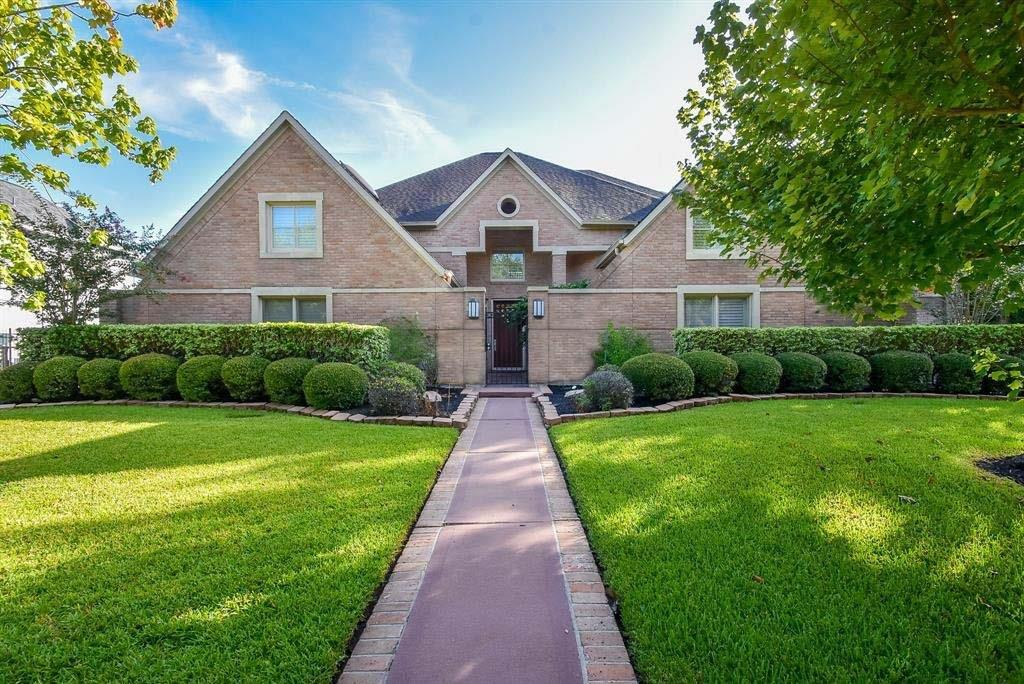 BRAND NEW ROOF in 2019. Rare opportunity to own a home located on prestigious Sweetwater Country Club Golf Course in Sugar Land. Enjoy the Country Club lifestyle from your own back yard with picturesque views of the 9th and 18th holes from the entry, kitchen, all living and dining spaces. The lush back yard provides ample room for a pool. The home boasts a wide, open floor plan, soaring ceilings, walls of windows with golf course views, a chef's kitchen featuring double ovens, 5 burner gas range with heavy duty vent hood, tons of cabinet space. A wet bar provides additional space for entertaining. Travertine floors throughout the lower floor, plantation shutters on front windows, and a curved staircase add to the drama of this floor plan. This home offers 5 bedrooms with 4 full bathrooms and 2 half baths. Two master bedrooms with sitting areas and large his and her closets. This home also boasts 4 rooms and a balcony overlooking the golf course.