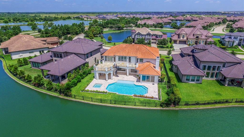 Please access virtual tour walk through!  Extraordinary Kickerillo custom home overlooking the most desired WATERFRONT settings in Lakes of Cross Creek.  This luxurious and distinctive home has stunning expansive views of the pool and lake from most rooms. Study is two story block paneled and suited for the busy executive. Incredible Kitchen offers Wolf double ovens, SubZero refrigerator & enormous furniture quality island with five burner gas cooktop. Kitchen is open to Family Room with fireplace, and expansive lake views.  Elegant Master Suite and Bath are down. Three very large bedrooms all with en suite access are upstairs, plus Gameroom, small wet bar, and 7x15 dual study / computer desks with built-ins. Incredible slate upper deck  can be accessed from three different rooms, + a spiral stair to the lower level, complete w/ summer kitchen, outdoor fireplace, and POOL with separate spa + access to an outdoor pool bath. This is an exceptional home offered at an exceptional price!