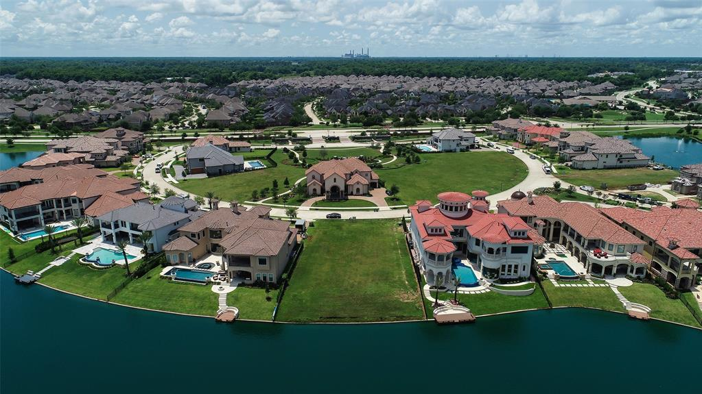 Magnificent and Beautifully Appointed Custom Showplace to be built on the last Available Waterfront Lot in the Exclusive Majestic Pointe Gated Community of Riverstone in Sugar Land. Views from this lot are some of the most spectacular ever on the 75 acre Lake Riverstone!!! Builder to be Highly Acclaimed and Long Time Award Winning Builder Peterson Home Builders, Inc. Along with the recently awarded 2018 Texas Star Award the builder has won numerous Pinnacle, Prism, and Texas Star Awards. Having partnered w\talented AISD designers, they have presented six spectacular Show Homes over the last two decades, the most of any home builder. One of these is located in the nearby Ivy Bend. Known for their innovative approach, acute attention to detail & integrity the builder has enjoyed long term relationships with devoted home owners. Contact Listing Agent for more details on floor plan. Photos of homes shown on past homes built by this builder to allow glimpse of his gorgeous designs.