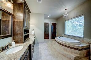 The master bath features double sinks, soaking tub and separate shower. There are also separate closets; one leads to the single car garage on the left side of the home.
