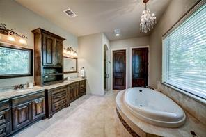 The master bath is equipped with double sinks, comfortable jetted tub and separate shower.