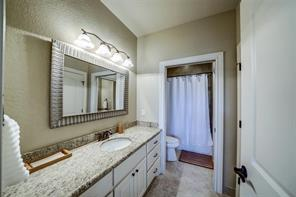 The third full bath is a hollywood style bathroom between the third and fourth bedrooms.