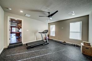 No excuses with your own personal fitness room! There is plenty of room for a treadmill, machines and weights.