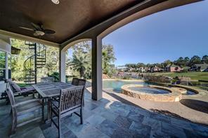 The outdoor entertaining space offers a salt water pool, spa and natural gas fire pit.
