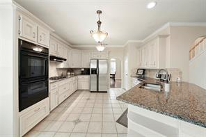 Double ovens, gas cooktop and loads of cabinet space in this kitchen! There is even space for a small island if desired!