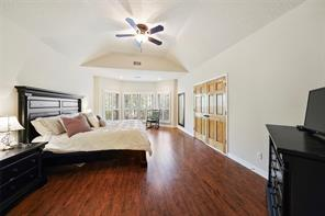 Large master bedroom with high ceilings, wood floors and double doors for a grand entry!