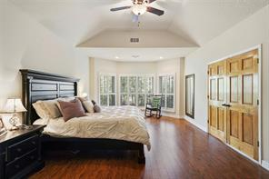 The master is large enough for a king size bed and additional seating area! The bay window overlooks the backyard and also features custom plantation shutters.