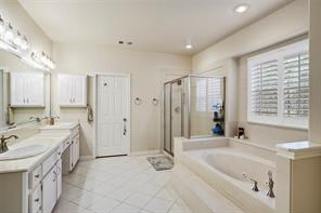 The neutral finishes in the master bath creates a clean and serene feel. Soak the day away in the large tub. Double sinks, separate shower, toilet room and large closet complete the area.