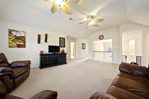 Three guest bedrooms, bonus room and large bath are just off of the game room.