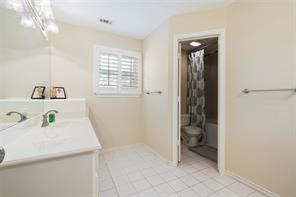 Second floor bath is large with two separate vanities and a separate toilet and tub/shower area.