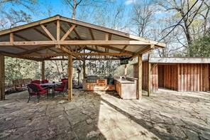 Covered patio is large and includes a built-in outdoor kitchen. This backyard is ready for some summer entertaining!