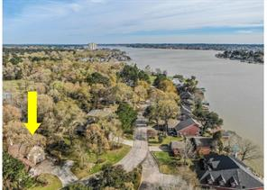 The home sits directly across the street from Lake Conroe with access to the neighborhood boat ramp.