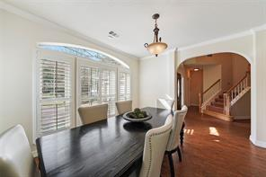 Large foyer with beautiful custom plantation shutters create a beautiful entry.