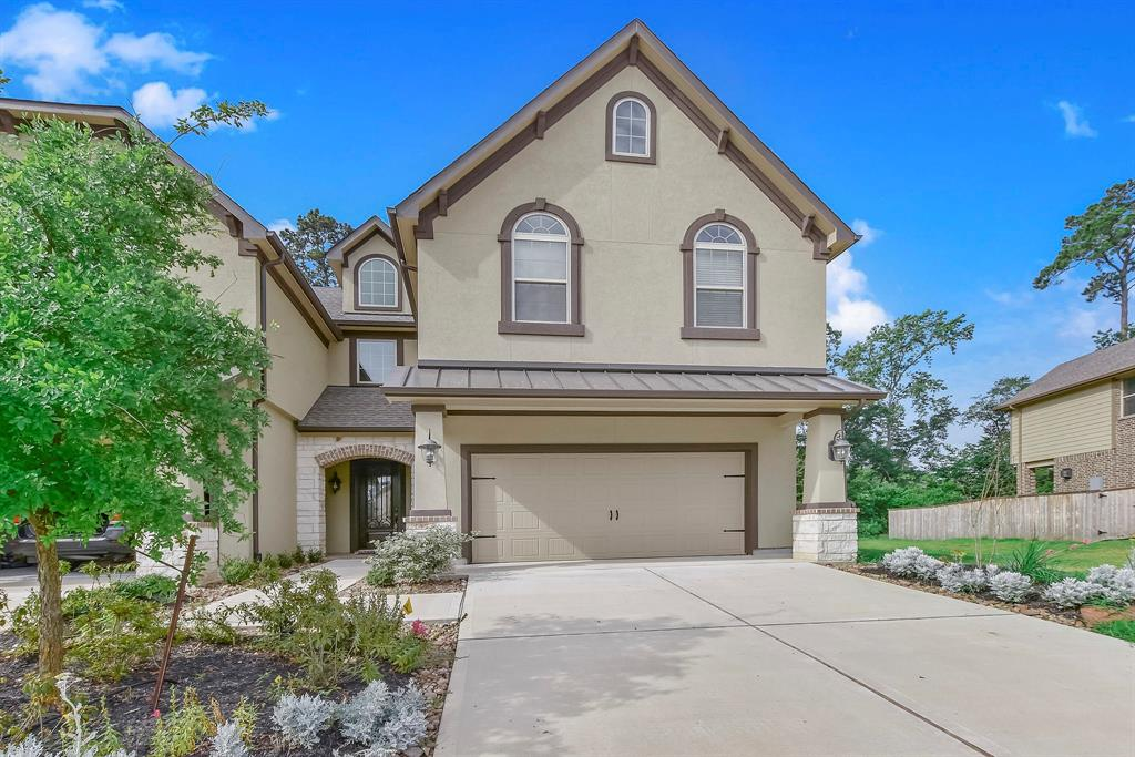 Beautiful Village builder Bordeaux plan.  Fantastic townhome with dream gourmet island kitchen, clay glazed white cabinets and Frigidaire stainless steel appliances. Granite countertops throughout home.  Wood floors downstairs.  Luxurious master suite with vanity, corner tub, large walk-it closet and private covered balcony.  Covered patio with pavers and 2nd balcony.